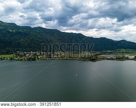 Aerial View On Steindorf And The Upper Ends Of Ossiacher Lake In Carinthia, Austria With Its Moor An