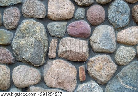 Wall Background. Fragment Of A Colored Stonewall. Natural Big Textured Stone.