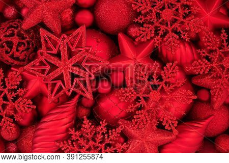 Red star, snowflake, droplet & ball bauble Christmas decorations. Festive greetings card background scene for the Xmas holiday season. Flat lay, top view.