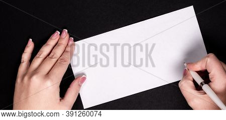 Female Hands Writing On White Paper With Vitage Pen With Copy Space