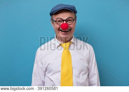 Portrait Of A Cheerful Man With Red Nose