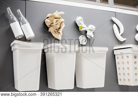 White Garbage Cans For Sorting Garbage.four Decorative Trash Bins For Sorting Of Waste. Place For A