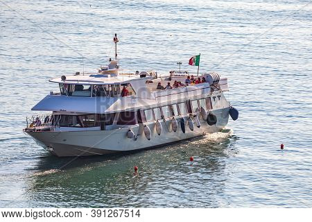 Portofino, Italy. October 20, 2017: Tourist Ferry With Tourists People On Board. In The Mediterranea