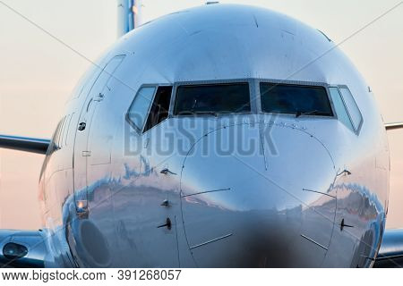 Close-up Front Of The Fuselage Of The Passenger Airplane
