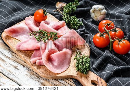 Cutted Ham Sausage. Traditional German Boiled Ham. White Wooden Background. Top View