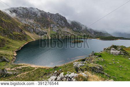 Lago Del Valle Lake In Somiedo National Park In Asturias, Spain On A Rainy Autumn Day. Scenic Autumn