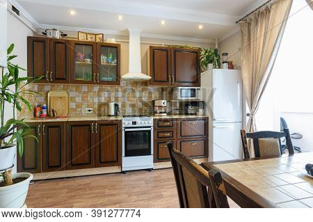 Classic Wood Grain Kitchen Set And Dining Table In The Interior Of The Kitchen