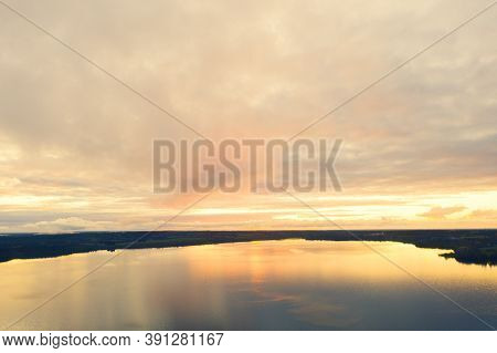 Aerial View Sunset Over The Forest And Lake. View From Drone. Aerial  View Cloudscape. Texture Of Cl