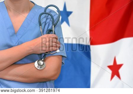 Female Surgeon Or Doctor With Stethoscope In Hand On The Background Of The Panama Flag. Surgery Conc
