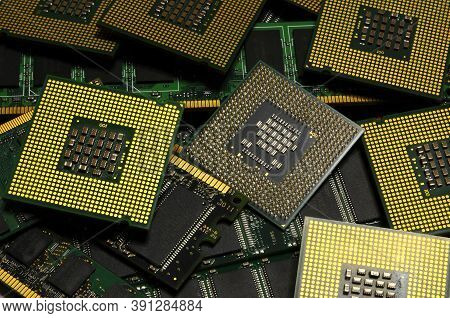 Closeup On Pile Of Many Computer Cpu Processors.