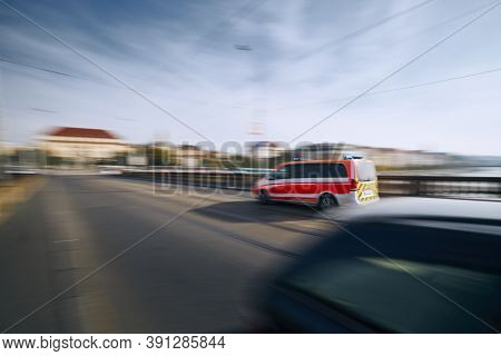 Ambulance Car In Blurred Motion. Themes Emergency Medical Service, Urgency And Health Care.