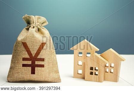 Yuan Yen Money Bag And Residential Buildings. Mortgage Loan. City Municipal Budget. Costs Of Service