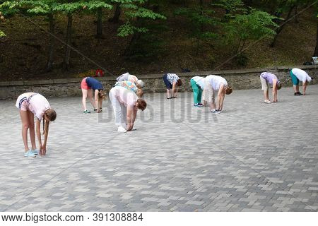 Pyatigorsk. Russia. August 2020. People Doing Yoga In A Public Park In Morning Outdoor. A Group Of W