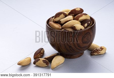 Brazil Nuts In Wooden Bowl On White Background
