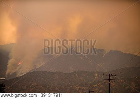 A View Of The Spreading Flames From The Canyon Fire. Wildfire In Hills And The La City.