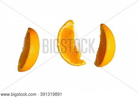 Three Sliced Orange Slices Isolated In The Air On White Background
