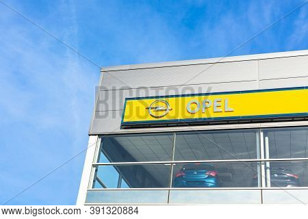 Opel Brand Logo On Bright Blue Sky Background Located On Its Dealer Office Building In Lyon, France