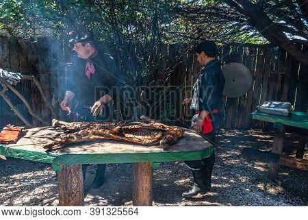 Riesco Island, Chile - December 12, 2008: Posada Estancia Rio Verde Working Farm. 2 Ranch Hands Cut
