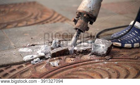 Working With A Jackhammer On The Slab. Legs Of A Worker With A Jackhammer Smashing A Marble Slab. 4k