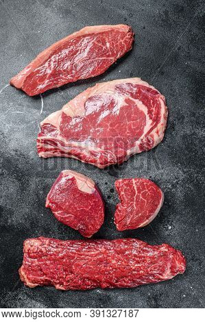 Variety Of Raw Black Angus Beef Meat Steaks Fillet Mignon, Ribeye, Striploin And Skirt Or Machete. D