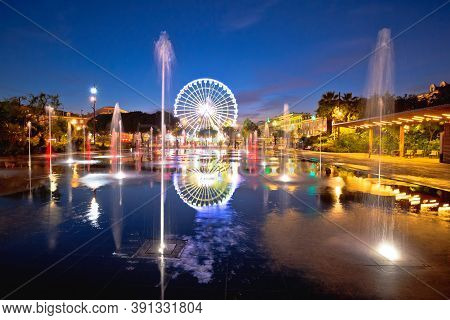 City Of Nice Ferris Wheel And Fountain Evening Mirror View, Alpes-maritimes Region Of France
