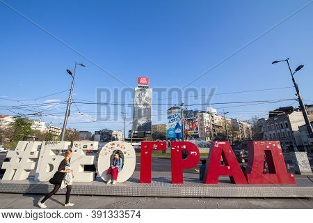 Belgrade, Serbia - April 6, 2019: Girls Posing And Walking Around A Touristic Sign With The Name Bel