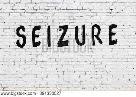 Inscription Seizure Written With Black Paint On White Brick Wall.
