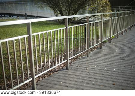 Fence In The Park. Metal Fencing. A Fence Around The Lawn. Park Area. Fence On A Sunny Day.