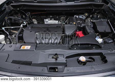 Novosibirsk, Russia - October 16, 2020: Mitsubishi Outlander, Car Engine Close-up. Internal Combusti
