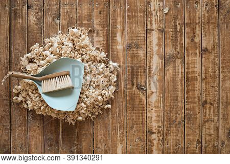 Broom And Dustpan On Wooden Floor. Cleaning Concept.
