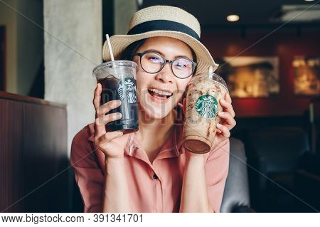 Chiang Mai, Thailand : 22/07/2020 : Tourist Woman Holding A Cup Of Choco-choco Nutty Frappuccino Wit