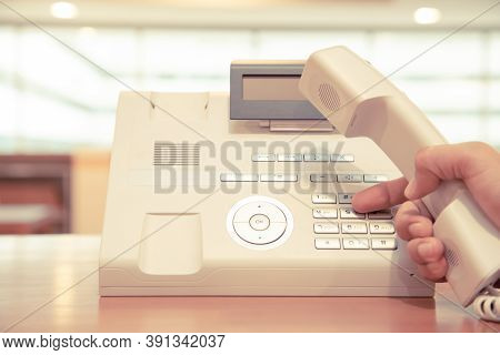 The Hand Picks Up The Phone And Pressing The Button On The Office Phone Or Old Telephone.