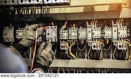 Electrical Engineer Using Measuring Equipment To Checking Electric Current Voltage At Circuit Breake