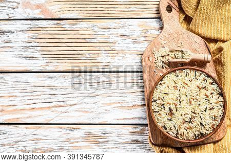 Jasmine, Brown, Red And Black Rice In A Bowl. Mixed Rice And Riceberry. White Background. Top View.