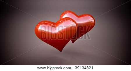 Shiny red hearts on a dark gray background, vignetting