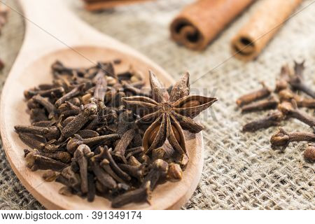 Clove Spice And Badyan Close-up In A Wooden Spoon. Natural Herbal Plant, Spices Seasoning Conceptual