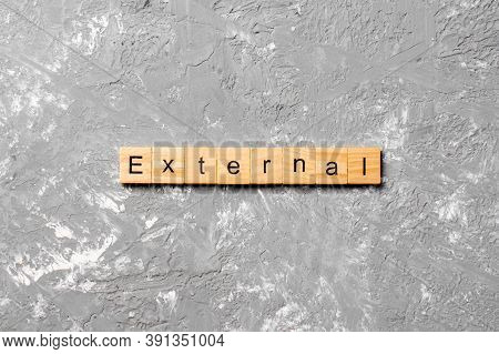 External Word Written On Wood Block. External Text On Cement Table For Your Desing, Concept