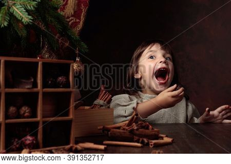 A Four-year-old Girl Stealthily Eats Chocolates From The Christmas Table. Genre Portrait In Retro St