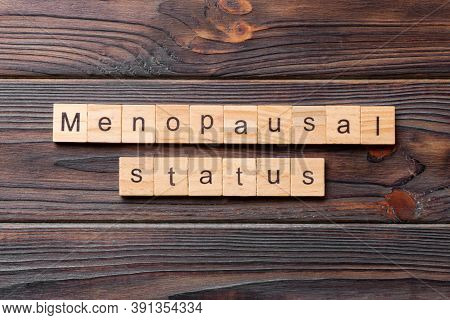 Menopausal Status Word Written On Wood Block. Menopausal Status Text On Cement Table For Your Desing