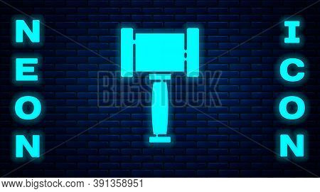 Glowing Neon Judge Gavel Icon Isolated On Brick Wall Background. Gavel For Adjudication Of Sentences