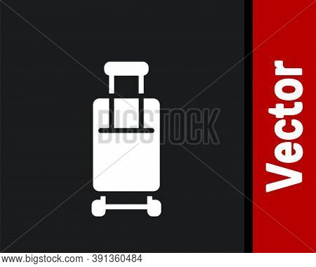White Suitcase For Travel Icon Isolated On Black Background. Traveling Baggage Sign. Travel Luggage