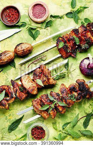 Grilled Meat Skewers Or Shish Kebab Pickled In Nettle.bbq Meat On Skewers
