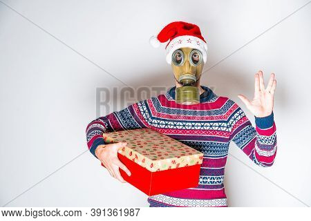 Anonymous Person With Symbol Of Vulcan Salutation In Christmas Clothes On Light Background