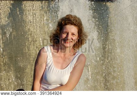 Young Woman Posing, City Waterfall, Clear Water, Joy, Relaxing In The Park