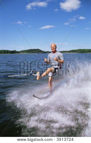 Man Water-Skiing On One Leg