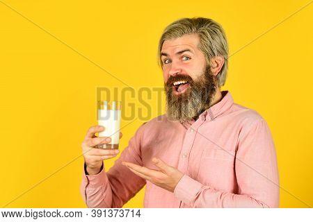 Fermented Foods Healthy Eating Concept. Happy Farmer Present Milk Glass. Bearded Man Drink Useful Mi