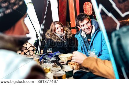 Happy Friends Drinking Beer And Eating Chips At Apreski Outdoors - Young People Having Fun Together