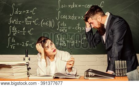 Shocked And Tired. Shocked Student Covering Face By Hand. Sexy Woman Sit At Teachers Table. Bearded