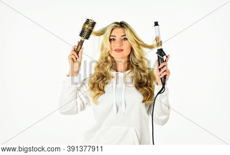 Create Hairstyle. Woman With Long Curly Hair Use Curling Iron. Hairdresser Tips. Using Different Wra
