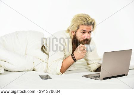 Too Busy. Man Working On Laptop And Phone In Bed. Male Spending Time In Room Using Pc. Relax Lifesty
